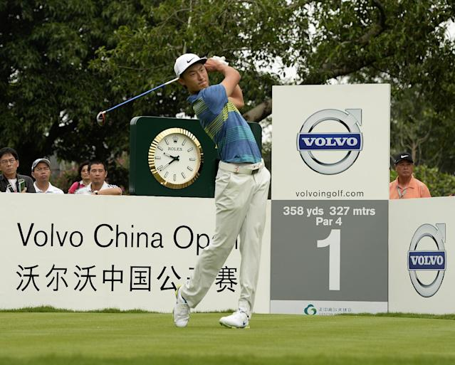 In this photo released by OneAsia, Li Haotong of China watches his shot during the third round of the Volvo China Open at Genzon Golf Club in Shenzhen, southern China, Saturday, April 26, 2014. (AP Photo/OneAsia, Paul Lakatos)
