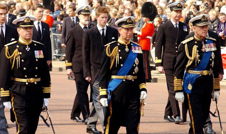 403364 06: Britain's Prince Charles (R), Prince Phillip (C) and Prince Andrew (L) lead Prince Harry and other Royals as they walk behind the coffin bearing the Queen Mother April 5, 2002 as her ceremonial procession makes its way down the Mall in London. The Queen Mother's body will lie in state in Westminster Hall before her funeral in four days. (Photo by Anthony Harvey/Getty Images)