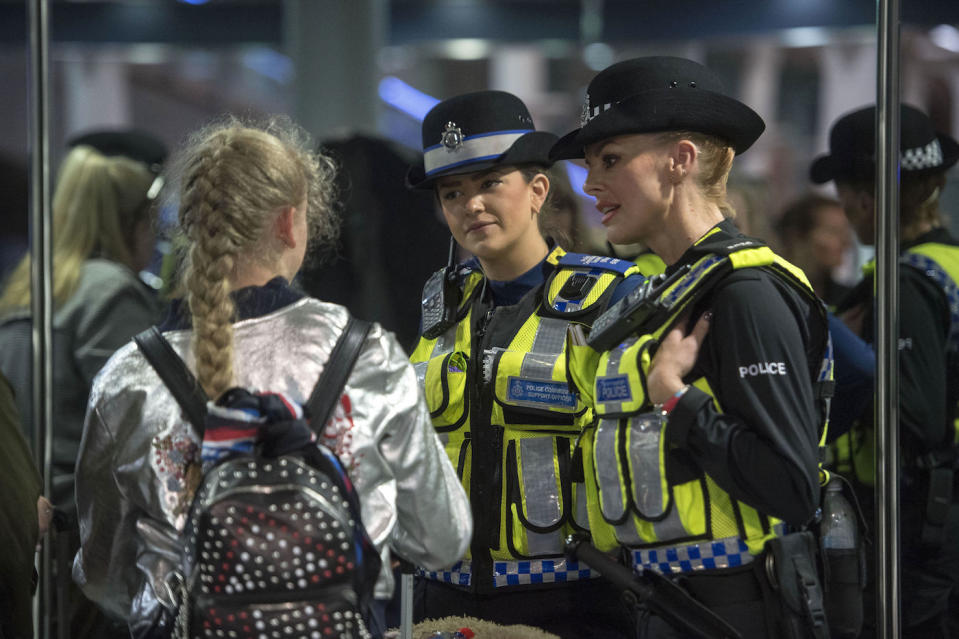 Embargoed to 1800 Tuesday September 12 Two officers from British Transport Police talk to a young passenger while taking part in operation Limelight at the Eurostar terminal at St Pancras International in London, which is aimed at safeguarding children and vulnerable people from harmful practices and human trafficking.
