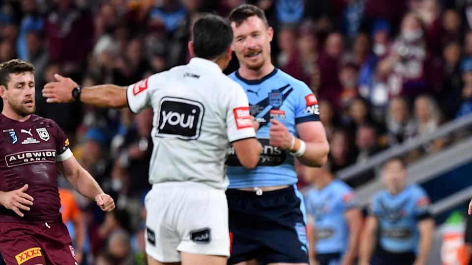 Damien Cook, pictured here speaking to Gerard Sutton during State of Origin III.
