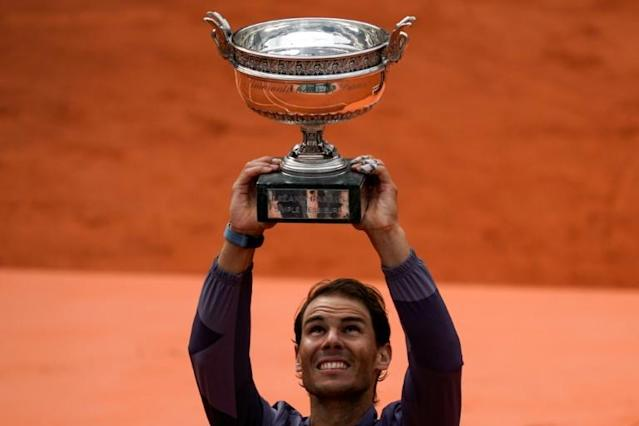 Spain's Rafael Nadal celebrates winning his 12th French Open title in 2019 (AFP Photo/Kenzo TRIBOUILLARD)