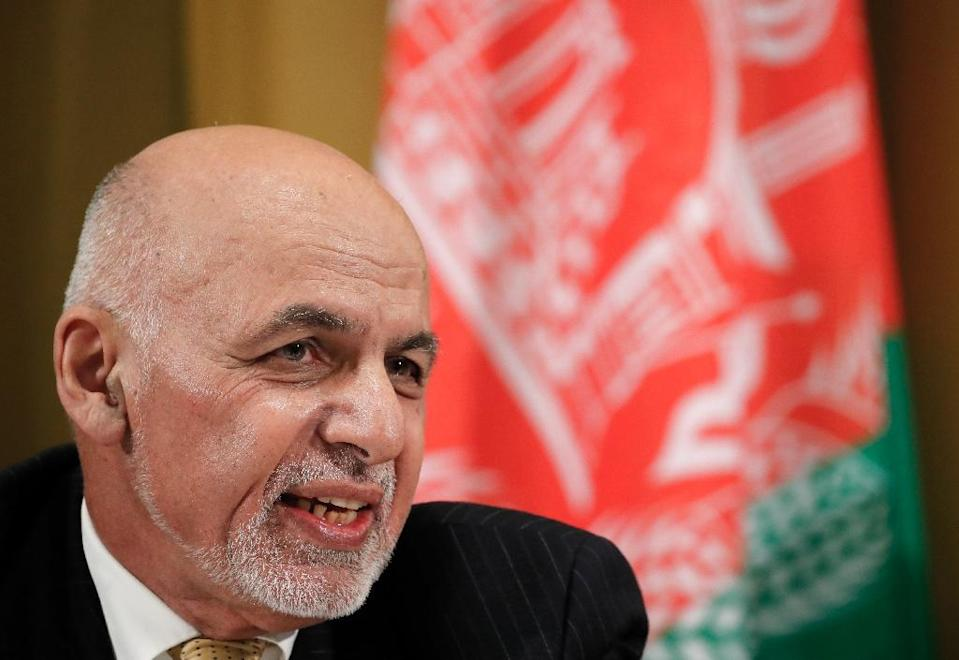 Afghan President Ashraf Ghani has warned against rushing into a deal, citing violence in the aftermath of the Soviet withdrawal in 1989 (AFP Photo/DENIS BALIBOUSE)