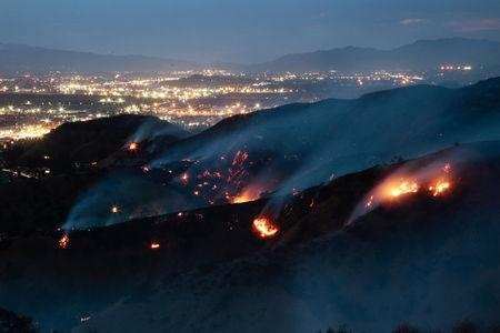 The La Tuna Canyon fire over Burbank. REUTERS/Kyle Grillot
