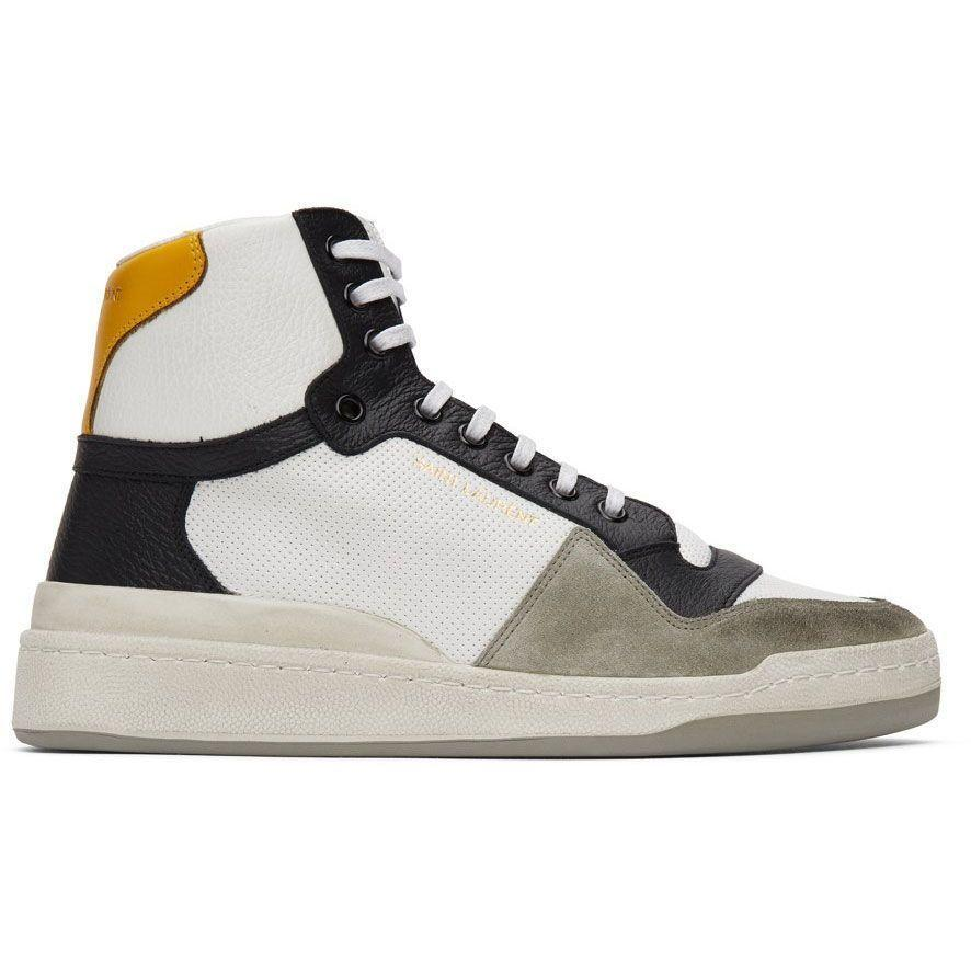 """<p><strong>SL24 High-Top Sneakers</strong></p><p>ssense.com</p><p><strong>$745.00</strong></p><p><a href=""""https://go.redirectingat.com?id=74968X1596630&url=https%3A%2F%2Fwww.ssense.com%2Fen-us%2Fmen%2Fproduct%2Fsaint-laurent%2Fwhite-and-yellow-paneled-high-top-sneakers%2F5567971&sref=https%3A%2F%2Fwww.esquire.com%2Fstyle%2Fmens-accessories%2Fadvice%2Fg2538%2Fluxury-sneaker-brands-worth-spending-money%2F"""" rel=""""nofollow noopener"""" target=""""_blank"""" data-ylk=""""slk:Shop Now"""" class=""""link rapid-noclick-resp"""">Shop Now</a></p><p>The brand that redefined the jean and the skinny suit has done the same for the luxury sneaker. Sure, it might feel like upscale takes on Vans Authentics and Air Jordan 1s, but it's on the nose of what many guys are looking for in designer fashion—the perfect mix of accessibility and exclusivity. It's fashion in the age of Instagram, meaning it isn't just about whether the shoe fits, but how good it looks on your feed.</p>"""