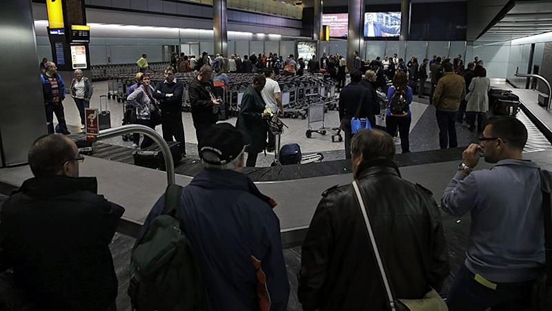 People wait in Heathrow Airport after a computer glitch closed London's airspace. Photo: AP