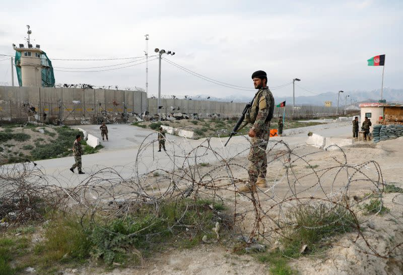 An Afghan National Army (ANA) soldier stands guard outside Bagram prison, north of Kabul, Afghanistan