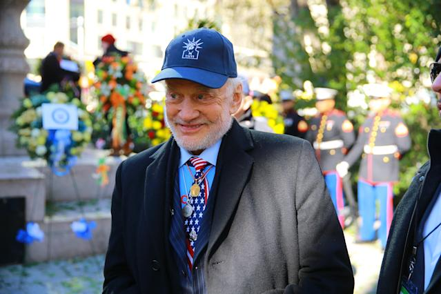 <p>Honorary Grand Marshall Buzz Aldrin shows off his tie during a ceremony before the Veterans Day parade on Fifth Avenue in New York on Nov. 11, 2017. (Photo: Gordon Donovan/Yahoo News) </p>
