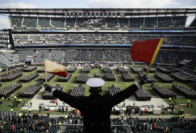 Navy Midshipman Frey Pankratz signals his classmates as they march onto the field ahead of their game against Army in 2018. (AP)