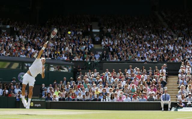 Roger Federer of Switzerland serves during his men's singles final tennis match against Novak Djokovic of Serbia at the Wimbledon Tennis Championships, in London July 6, 2014. REUTERS/Stefan Wermuth (BRITAIN - Tags: SPORT TENNIS)