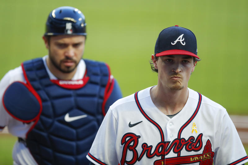 ATLANTA, GA - SEPTEMBER 05: Max Fried #54 of the Atlanta Braves returns to the dugout in the first inning of an MLB game against the Washington Nationals at Truist Park on September 5, 2020 in Atlanta, Georgia. (Photo by Todd Kirkland/Getty Images)