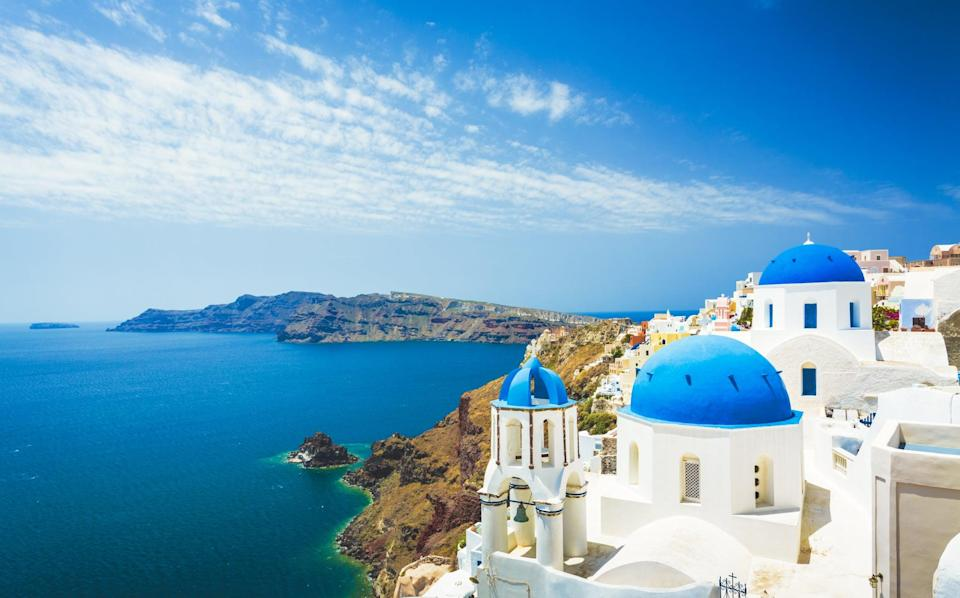 """<p><span class=""""nofilter"""">Santorini</span> is an island remaining after a volcanic eruption with a unique landscape of steep cliffs surrounding the beautiful blue waters of a lagoon that connects to the sea.</p>"""