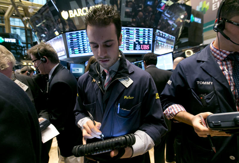 Trader Peter Cuttone works on the floor of the New York Stock Exchange Friday, April 4, 2014. Stocks are edging mostly higher in early trading Friday after the government reported that U.S. employers added to their payrolls last month. (AP Photo/Richard Drew)