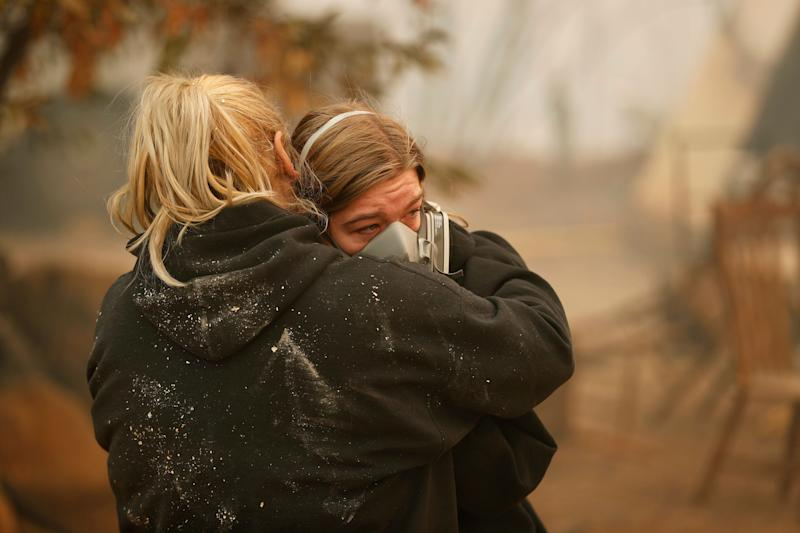 Krystin Harvey, left, comforts her daughter Araya Cipollini at the remains of their home burned in the Camp Fire, Saturday, Nov. 10, 2018, in Paradise, Calif. The Camp Fire is California's most destructive wildfire since record-keeping began. (Photo: ASSOCIATED PRESS)