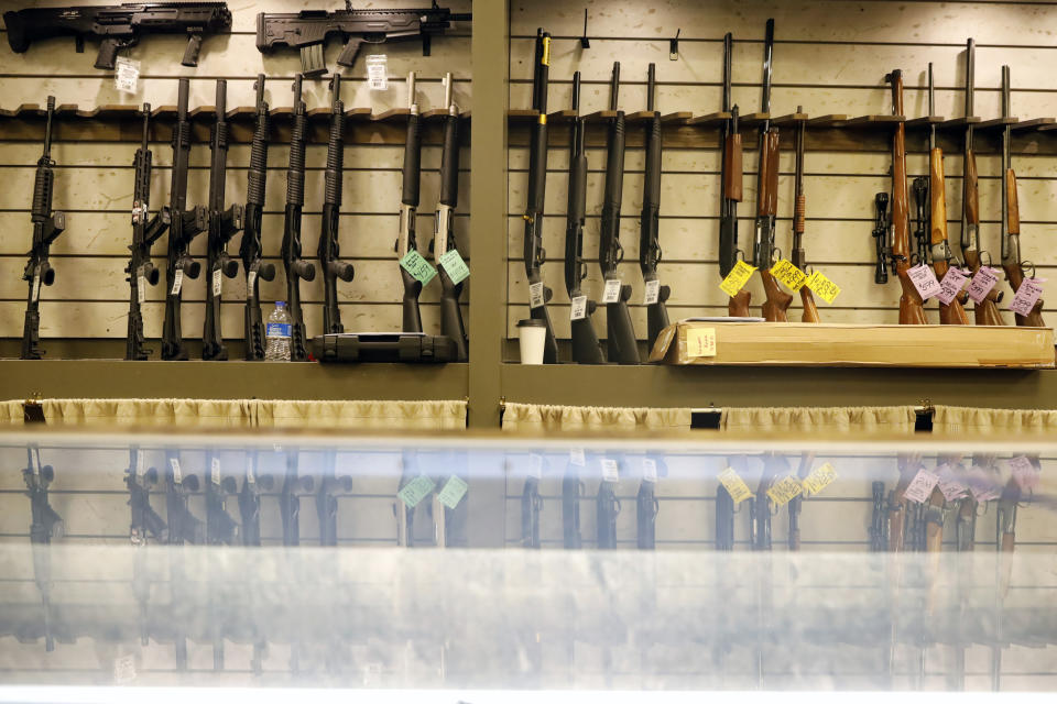 Guns are displayed in the showroom of Maxon Shooter's Supplies and Indoor Range, Friday, April 30, 2021, in Des Plaines, Ill. After a year of pandemic lockdowns, mass shootings are back, but the guns never went away. As the U.S. inches toward a post-pandemic future, guns are arguably more present in the American psyche and more deeply embedded in American discourse than ever before. The past year's anxiety and loss fueled a rise in gun ownership across political and socio-economic lines. (AP Photo/Shafkat Anowar)