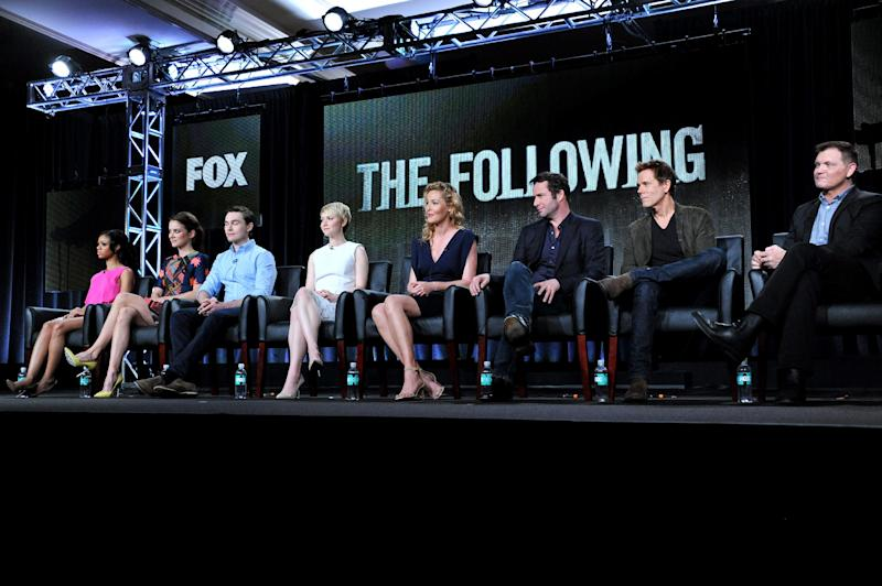 """From left, Tiffany Boone, Jessica Stroup, Sam Underwood, Valorie Curry, Connie Nielson, James Purefoy, Kevin Bacon, and creator Kevin Williamson are seen during the panel for """"The Following"""" at the FOX Winter 2014 TCA, on Monday, Jan. 13, 2014, at the Langham Hotel in Pasadena, Calif. The two stars of Fox's creepy thriller """"The Following"""" admit that their show gives them nightmares. Bacon and Purefoy both said today that the characters stick with them after work. (Photo by Richard Shotwell/Invision/AP)"""