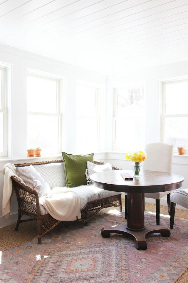 """<p>We believe that a sunroom with warmth and personal touches can be completed with items you may very well already have on hand: a gorgeous vintage table, a piece of charming wicker furniture, and a lovely rug underfoot.</p><p><strong>See more at <a href=""""https://www.thegritandpolish.com/blog/porch-house-kitchen-and-sunroom-a-reveal-2-years-in-the-making"""" target=""""_blank"""">The Grit and Polish</a>.</strong></p><p><a class=""""body-btn-link"""" href=""""https://www.amazon.com/HOME-BRILLIANT-Cushion-Decorative-Pillowcases/dp/B07L2QJG29/?tag=syn-yahoo-20&ascsubtag=%5Bartid%7C10050.g.31154392%5Bsrc%7Cyahoo-us"""" target=""""_blank"""">SHOP GREEN VELVET PILLOW COVERS</a></p>"""