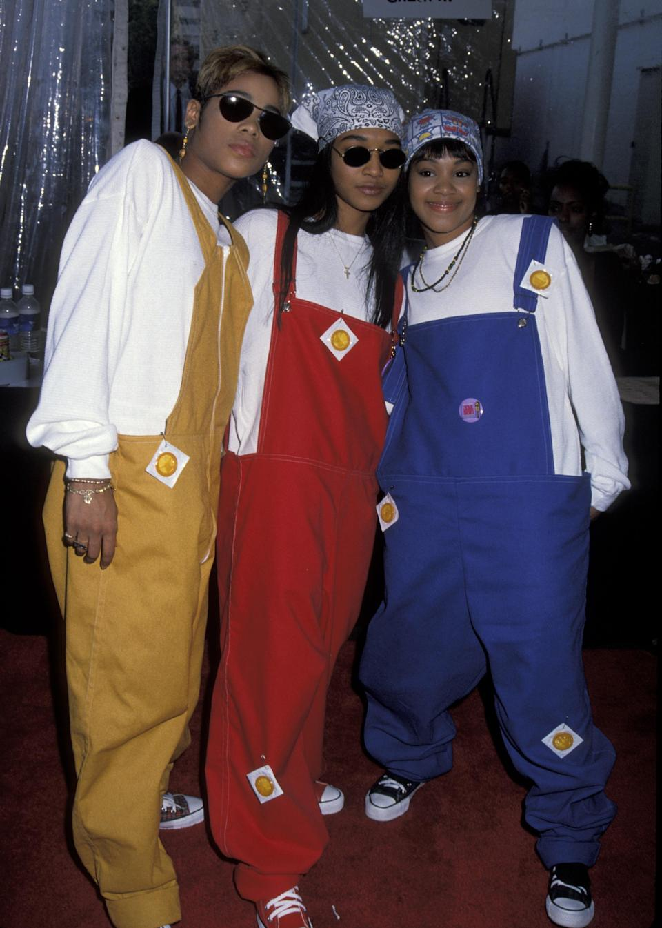 "<strong><h2>TLC</h2></strong>The hardest part of dressing like TLC is definitely going to be choosing a look. With a career spanning over a decade even before the death of member Lisa ""Left Eye"" Lopes, there are a lot to choose from. But comfort always takes priority for me, so these oversized overalls from the 90s are perfect. I'd recommend getting <u><a href=""https://www.amazon.com/Dickies-Mens-Overall-Brown-32X30/dp/B001T7SQWW/ref=sr_1_7?ie=UTF8&qid=1507043708&sr=8-7&keywords=mens+bib+overalls"" rel=""nofollow noopener"" target=""_blank"" data-ylk=""slk:men's overalls"" class=""link rapid-noclick-resp"">men's overalls</a></u> for that baggy look.<br><br>Stick some condoms on them to promote safe sex just like the members of TLC did. Accessorise with shades and bandanas to taste.<span class=""copyright"">Photo: Jim Smeal/Getty.</span>"