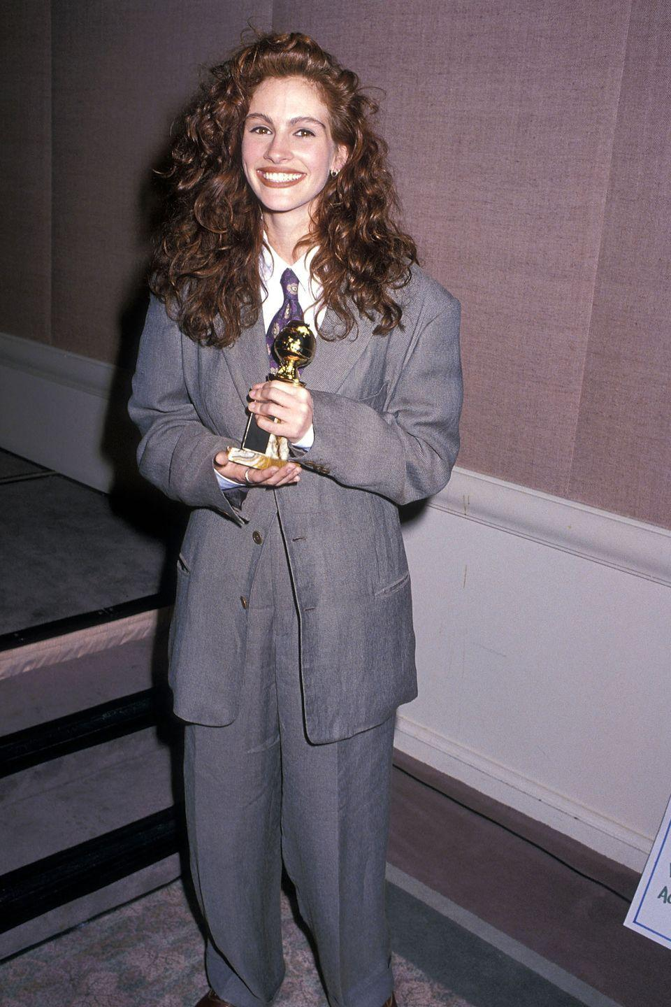 <p>America's Sweetheart opted for a suit instead of the typical award season gown in 1990.</p>