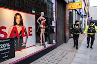 Security guards passing a Sale sign in London. Latest Covid-19 lockdown slams UK business owners. (Photo by May James / SOPA Images/Sipa USA)