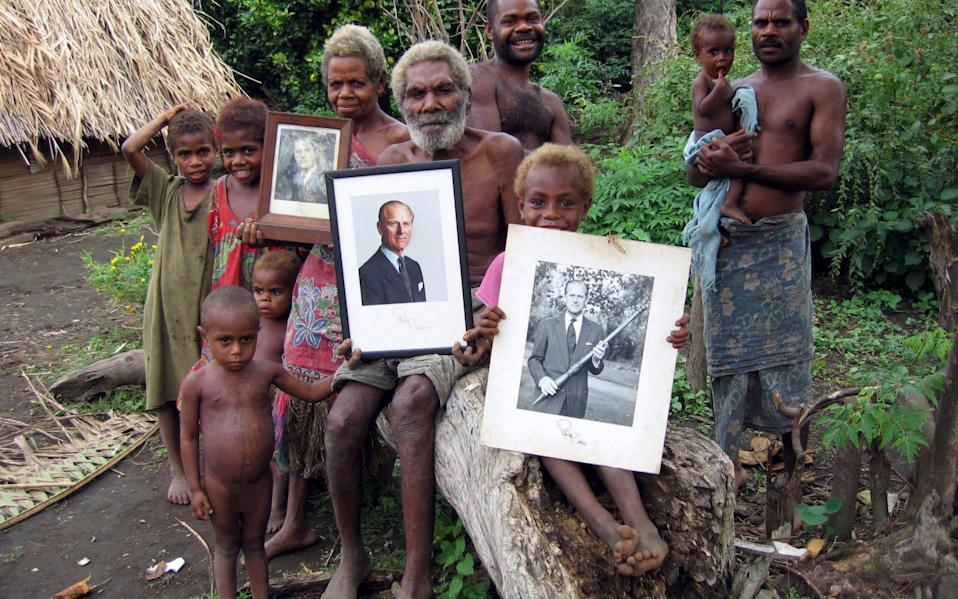 A cluster of villages on the island of Tanna has for decades worshiped Prince Philip as a god and he in turn sent them signed photographs - Rex Features