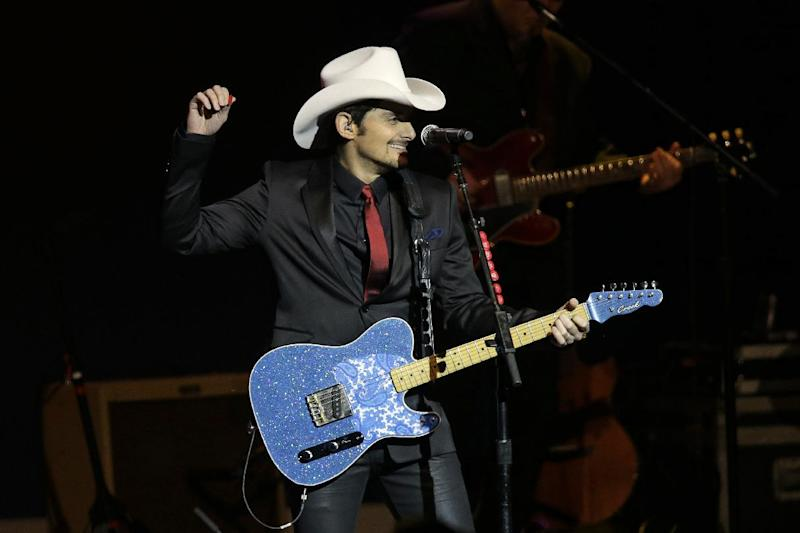 "FILE - Brad Paisley performs during The Inaugural Ball at the Washignton convention center during the 57th Presidential Inauguration in Washington on Monday, Jan. 21, 2013. Southern white men don't usually drive racial dialogue. For as long as race has riven America, they have been depicted more often as the problem than the solution. So the country music star must have been unsurprised at the days of widespread criticism of his new song ""Accidental Racist,"" which details the challenges facing a ""white man from the southland"" and then features LL Cool J rapping from a black perspective. (AP Photo/Paul Sancya)"
