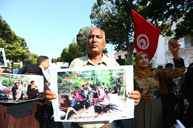 <p>Tunisian demonstrators hold banners during their protest against Myanmar's oppression towards Rohingya Muslims, on Avenue Habib Bourguiba in Tunis, Tunisia, Sept. 8, 2017. (Photo: Yassine Gaidi/Anadolu Agency/Getty Images) </p>