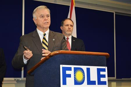 FDLE Commissioner Gerald Bailey, with Assistant FDLE Commissioner Jim Madden, announces an investigation into evidence tampering during a news conference in Tallahassee