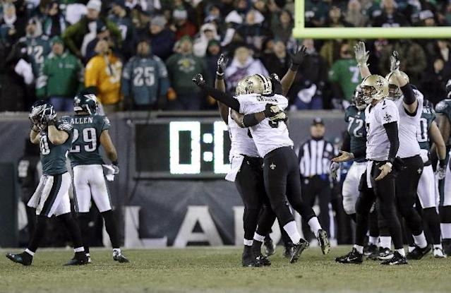 New Orleans Saints' Shayne Graham celebrates after kicking the game-winning field goal during the second half of an NFL wild-card playoff football game against the Philadelphia Eagles, Saturday, Jan. 4, 2014, in Philadelphia. The Saints won 26-24. (AP Photo/Julio Cortez)
