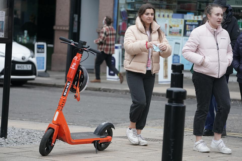 An e-scooter in Jesmond, Newcastle, where a fleet of 250 orange electric scooters has been opened up to the public. (PA)