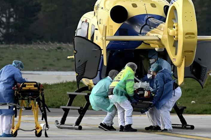 A patient is loaded into a helicopter at Paris Orly Airport, which has been transformed into an emergency evacuation air base for coronavirus sufferers (AFP Photo/Philippe LOPEZ)