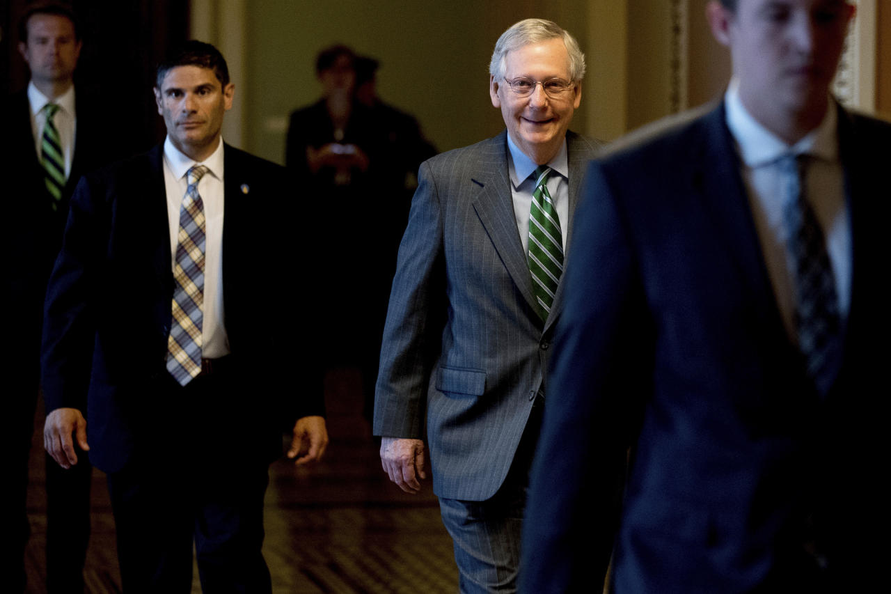 <p> Senate Majority Leader Mitch McConnell of Ky. arrives on Capitol Hill in Washington, Thursday, June 22, 2017, as Senate Republicans work on a health reform bill. Senate Republicans would cut Medicaid, end penalties for people not buying insurance and erase a raft of tax increases as part of their long-awaited plan to scuttle Barack Obama's health care law. (AP Photo/Andrew Harnik) </p>