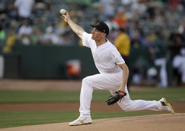 Oakland Athletics pitcher Chris Bassitt works against the San Francisco Giants during the first inning of a baseball game Saturday, Aug. 24, 2019, in Oakland, Calif. (AP Photo/Ben Margot)