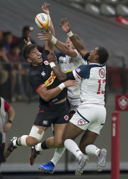 Canada's DTH Van Der Merwe tries to gain control of the ball against United States' Martin Iosefo and Marcel Brache during the first half of a rugby match in Vancouver, British Columbia, Saturday, Sept. 7, 2019. (Jonathan Hayward/The Canadian Press via AP)
