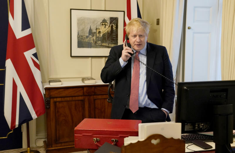 LONDON, ENGLAND - MARCH 25: Prime Minister Boris Johnson on the telephone to Queen Elizabeth II for her Weekly Audience during the coronavirus (COVID-19) pandemic at 10 Downing Street on March 25, 2020 in London, England. (Photo by Andrew Parsons-WPA Pool/Getty Images)