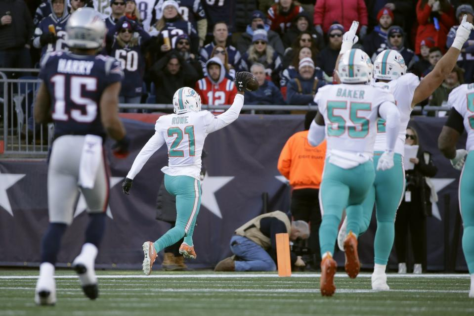 Miami Dolphins cornerback Eric Rowe (21) had a pick-six against his former team on Sunday (AP/Elise Amendola)