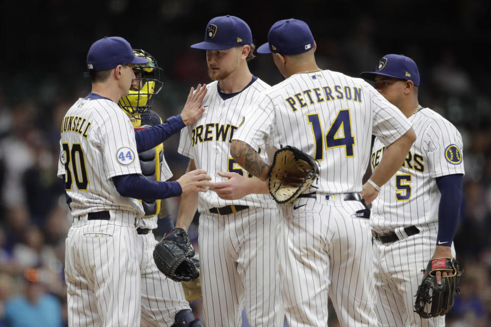 Milwaukee Brewers' Craig Counsell (30) congratulates Eric Lauer as he removes him from the game during the seventh inning of a baseball game against the New York Mets Friday, Sept. 24, 2021, in Milwaukee. (AP Photo/Aaron Gash)