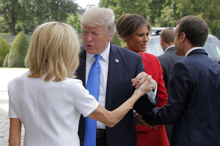 <p>French President Emmanuel Macron, right, welcome First Lady Melania Trump while and his wife Brigitte, left, welcomes President Donald Trump at Les Invalides museum in Paris Thursday, July 13, 2017. (Photo: Michel Euler/AP) </p>