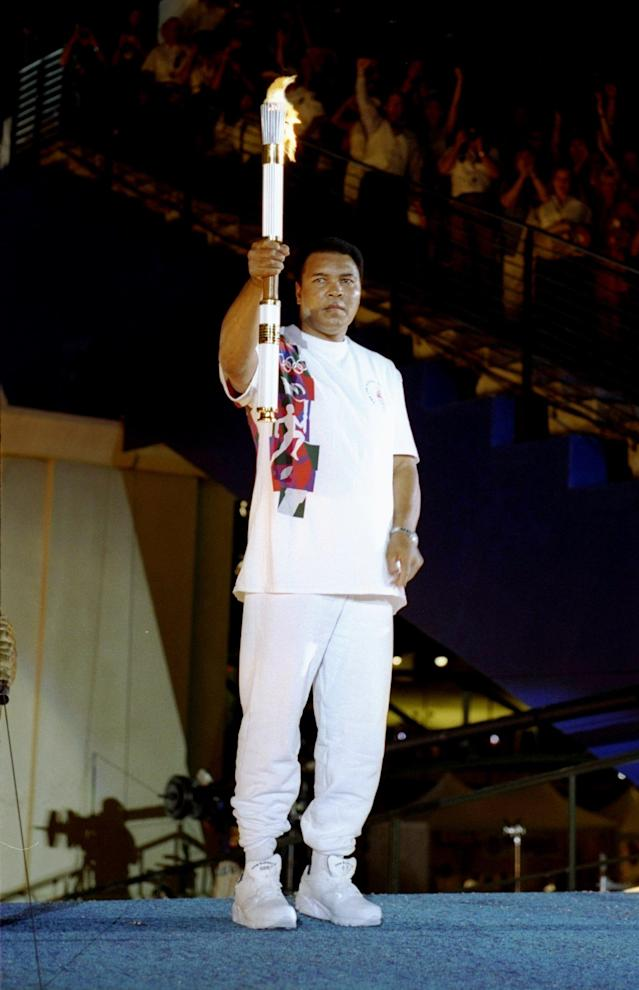 Muhammad Ali holding the Olympic torch at the 1996 Olympics in Atlanta. (Photo: Getty Images).