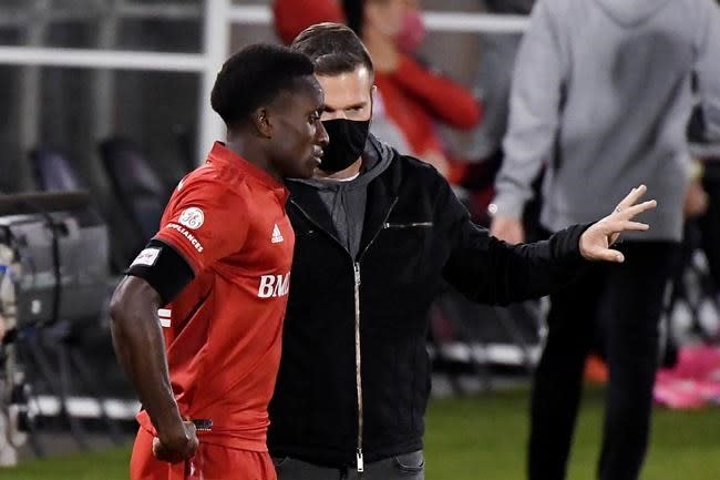 Toronto FC coach has to watch young sons go into quarantine from a distance