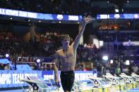 Bobby Finke waves after winning the men's 800 freestyle during wave 2 of the U.S. Olympic Swim Trials on Thursday, June 17, 2021, in Omaha, Neb. (AP Photo/Jeff Roberson)