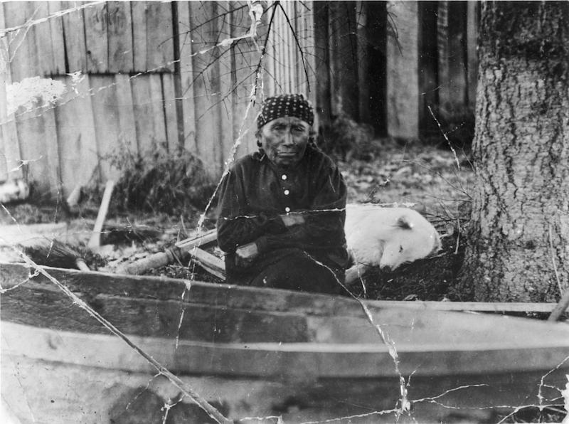 Mary Adams and Jumbo, one of the last woolly dogs, circa 1912.