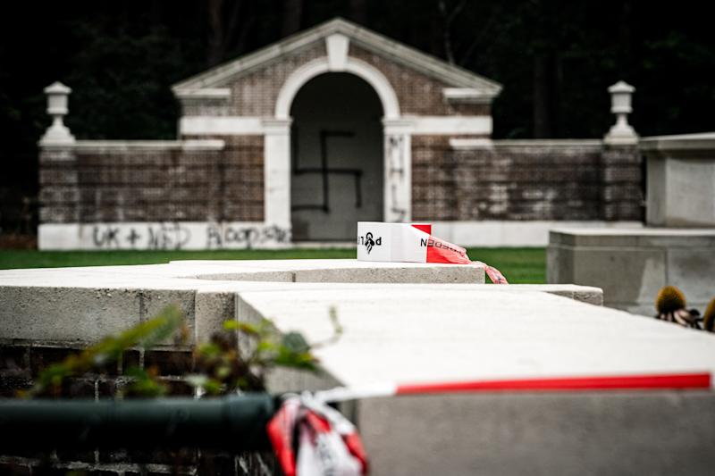 A picture taken on September 13, 2019 shows a large swastika was daubed on the inner wall of the chapel in the British World War II Commonwealth Graves cemetery in Mierlo, east of Eindhoven, Netherlands, on September 13, 2019. (Photo by Rob Engelaar / ANP / AFP) / Netherlands OUT (Photo credit should read ROB ENGELAAR/AFP/Getty Images)