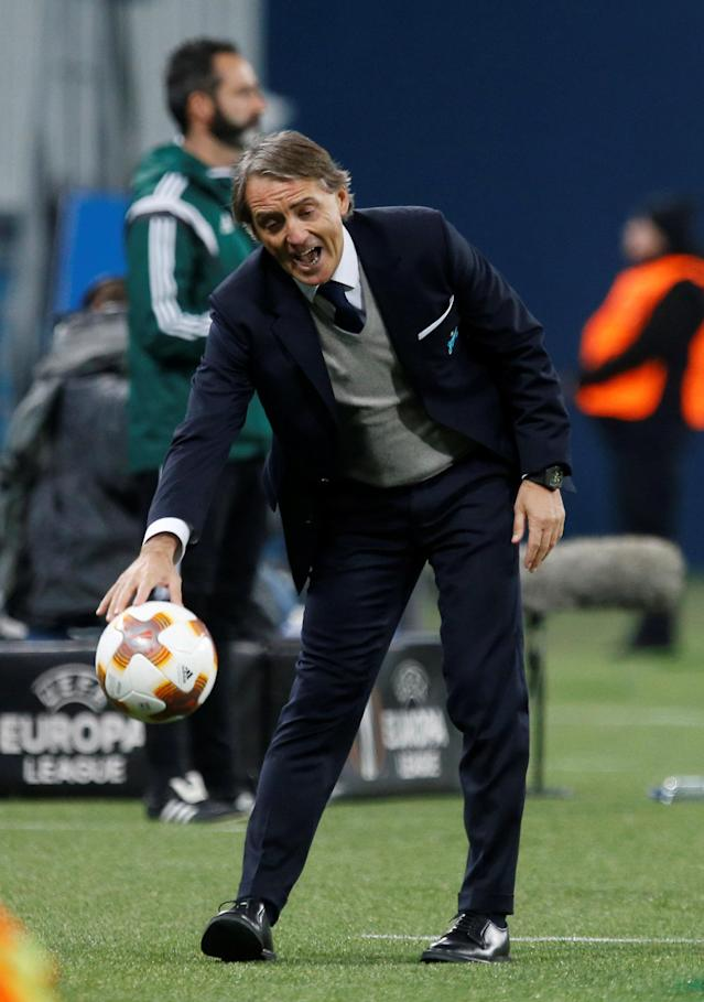 Soccer Football - Europa League Round of 32 Second Leg - Zenit Saint Petersburg vs Celtic - Stadium St. Petersburg, Saint Petersburg, Russia - February 22, 2018 Zenit St. Petersburg coach Roberto Mancini collects the ball REUTERS/Anton Vaganov
