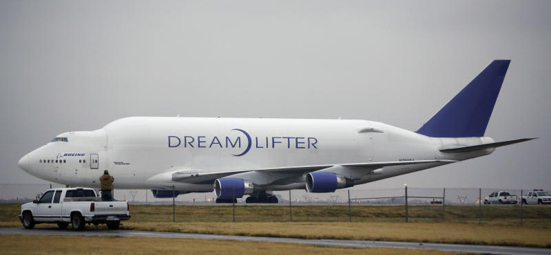 <p> A man takes a photo of the Boeing 747 LCF Dreamlifter from the back of his truck, Thursday, Nov. 21, 2013, after the aircraft accidentally landed at Col. James Jabara Airport in Wichita, Kan. Wednesday night. Boeing says the Dreamlifter, a 747 jumbo jet used to haul parts for construction of its new 787 Dreamliner, landed safely at Jabara, about eight miles from McConnell Air Force Base in Wichita where it was supposed to land. (AP Photo/Wichita Eagle, Jaime Green) LOCAL TV OUT; MAGS OUT; LOCAL RADIO OUT; LOCAL INTERNET OUT