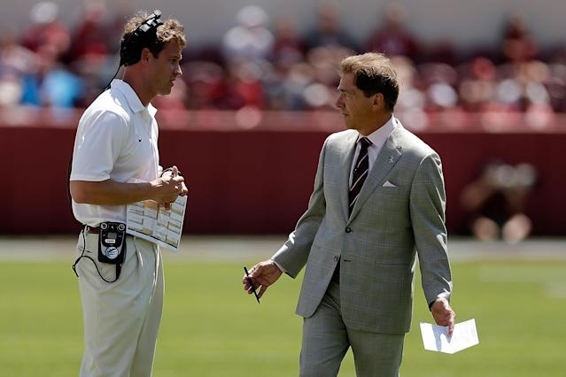 TUSCALOOSA, AL - APRIL 19: Head coach Nick Saban of the Alabama Crimson Tide speaks with offensive coordinator Lane Kiffin during the Alabama A-Day spring game at Bryant-Denny Stadium on April 19, 2014 in Tuscaloosa, Alabama. (Photo by Stacy Revere/Getty Images)