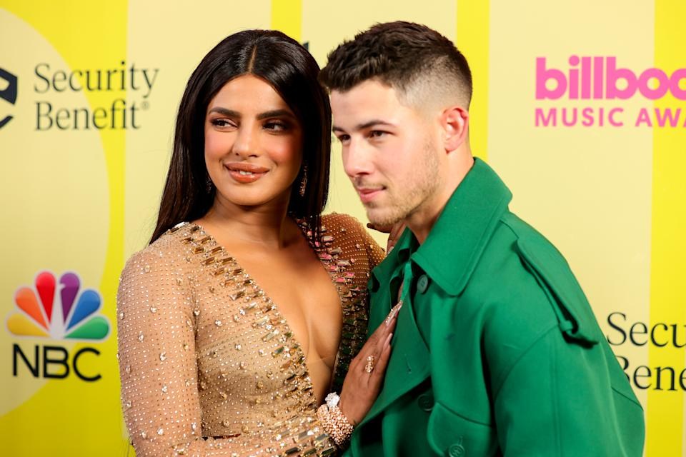 LOS ANGELES, CALIFORNIA - MAY 23: (L-R) Priyanka Chopra Jonas and Nick Jonas pose backstage for the 2021 Billboard Music Awards, broadcast on May 23, 2021 at Microsoft Theater in Los Angeles, California. (Photo by Rich Fury/Getty Images for dcp)