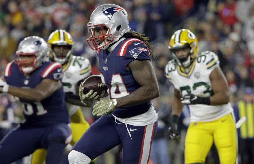 New England Patriots wide receiver Cordarrelle Patterson (84) runs from Green Bay Packers linebacker Reggie Gilbert (93) during the first half of an NFL football game, Sunday, Nov. 4, 2018, in Foxborough, Mass. (AP Photo/Steven Senne)