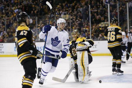 Apr 25, 2018; Boston, MA, USA; Toronto Maple Leafs center Auston Matthews (34) reacts in front of Boston Bruins goalie Tuukka Rask (40) after a goal is scored during the first period in game seven of the first round of the 2018 Stanley Cup Playoffs at TD Garden. Mandatory Credit: Greg M. Cooper-USA TODAY Sports
