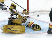 Vegas Golden Knights goaltender Marc-Andre Fleury lies on the ice with the puck in the net on a goal by Montreal Canadiens' Josh Anderson during overtime in Game 3 of an NHL hockey semifinal series, Friday, June 18, 2021, in Montreal. (Paul Chiasson/The Canadian Press via AP)