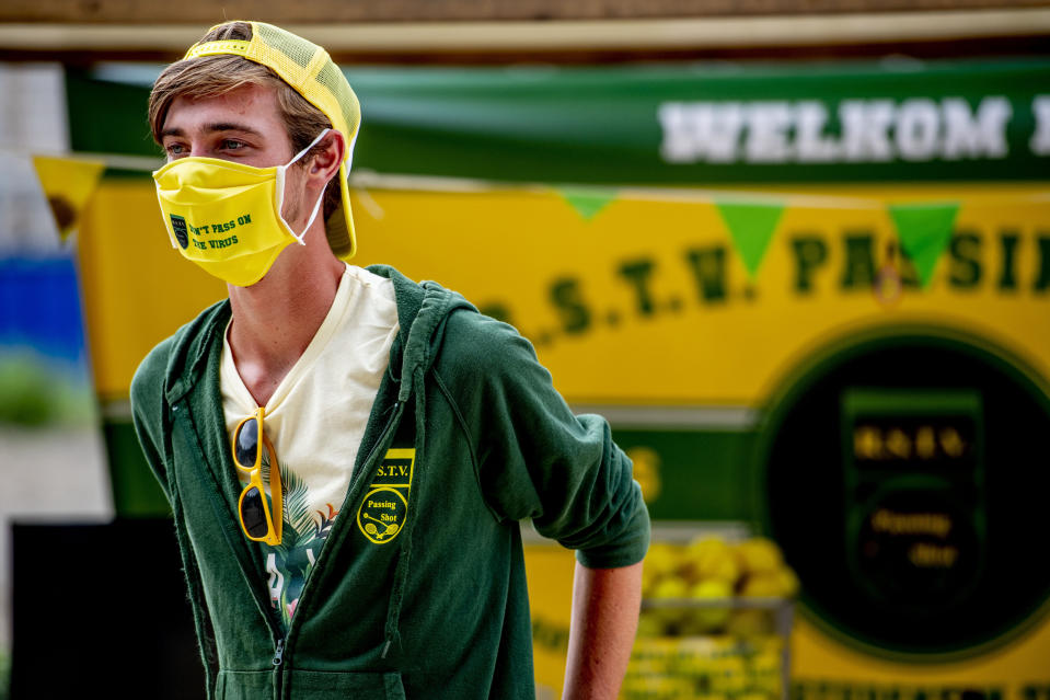 ROTTERDAM, NETHERLANDS - 2020/08/17: A student seen wearing a facemask in the information market during Eurekaweek. Eurekaweek also known as the introduction week for the new academic year for Erasmus University Rotterdam where students get to know their university. The Eurekaweek will take place in a different form this year due to the coronavirus pandemic, it will be divided into three physical days and one online day however all activities will be in line with measures set by government for Covid-19. (Photo by Robin Utrecht/SOPA Images/LightRocket via Getty Images)